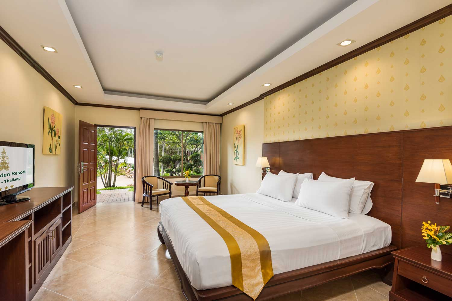Deluxe hotel room with pool view of the Thai Garden Resort in Pattaya, Thailand.