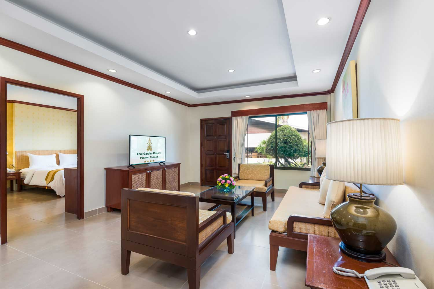 The living room of a disabled deluxe apartment hotel room of the Thai Garden Resort in Pattaya, Thailand