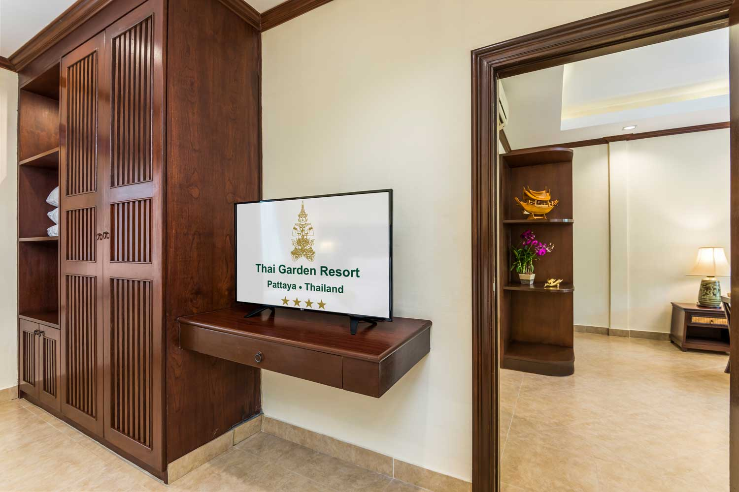 TV of a One-Bedroom apartment hotel room with a garden view of the Thai Garden Resort in Pattaya, Thailand