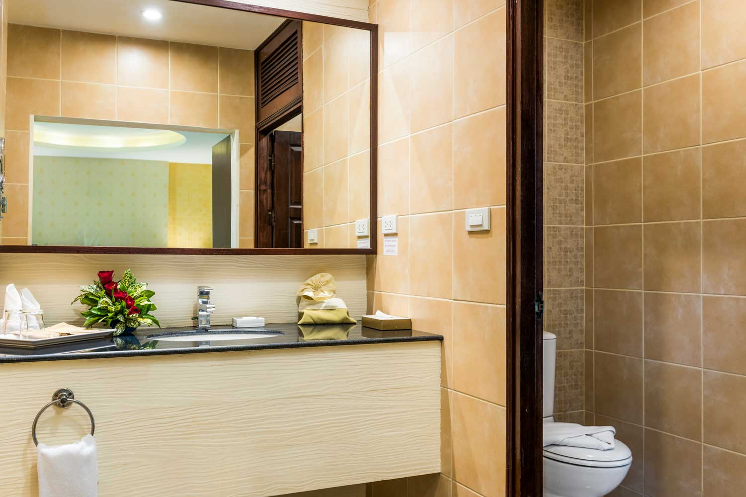 The Bathroom of a superior hotel room with a garden view of the Thai Garden Resort in Pattaya, Thailand.