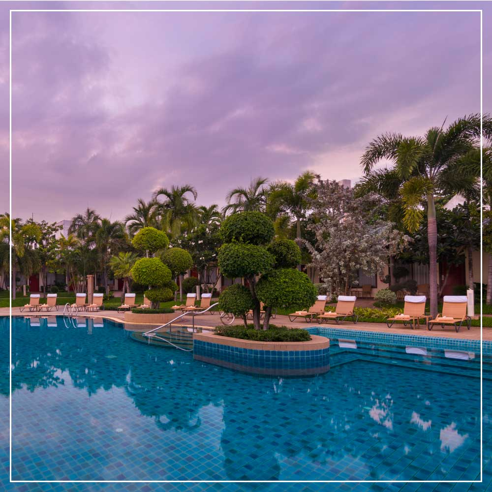 Relax at our lagoon like swimming pool at our tropical garden paradise