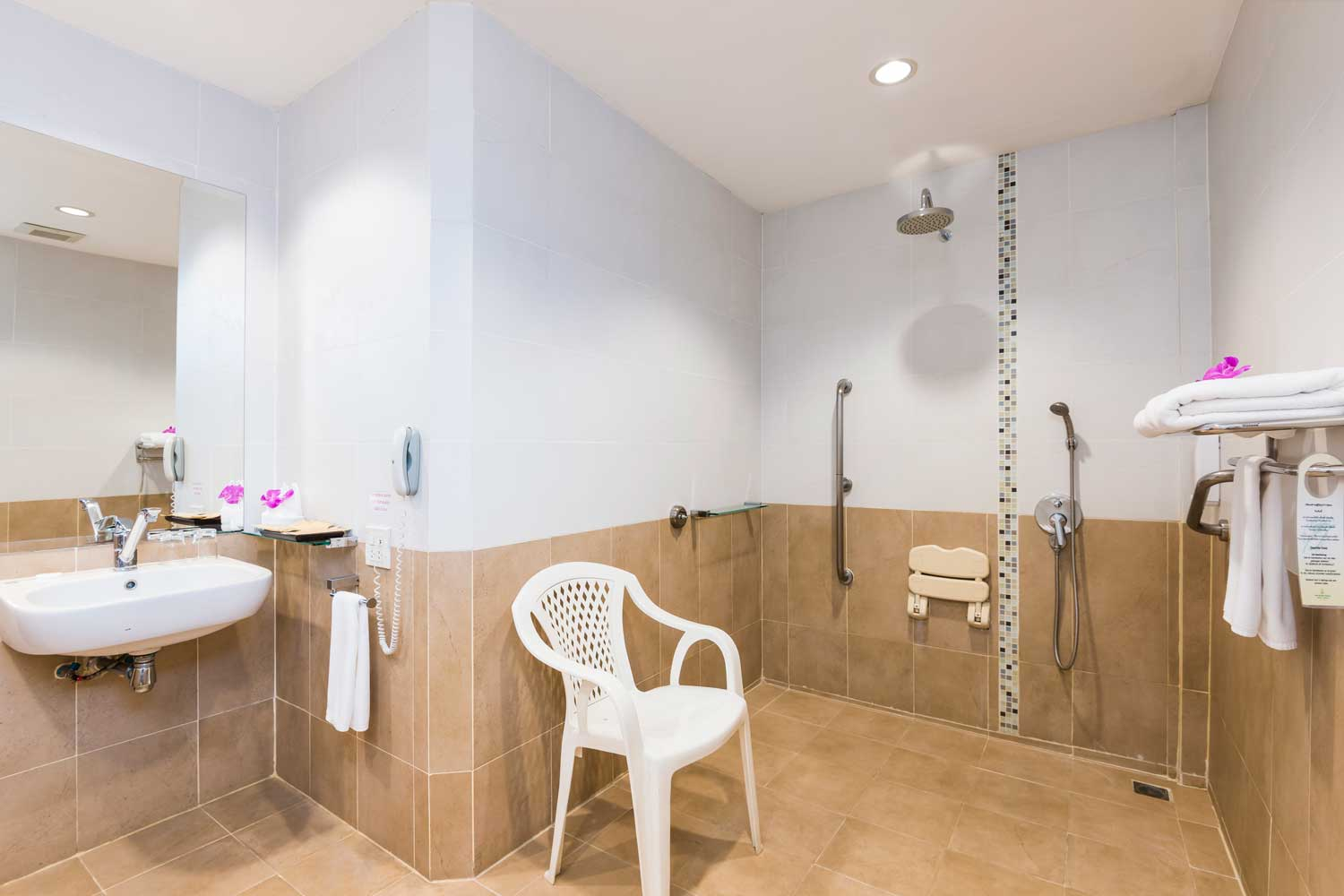 The bathroom of a disabled deluxe apartment hotel room of the Thai Garden Resort in Pattaya, Thailand