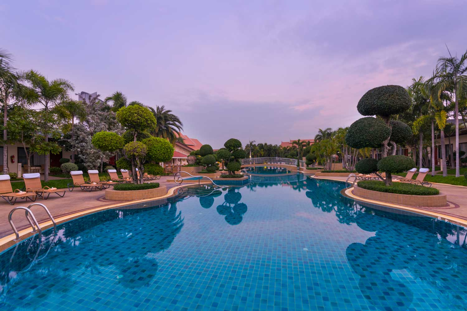 Lagoon Pool and Gardens in the morning at Sunrise at the Thai Garde Resort in Pattaya, Thailand