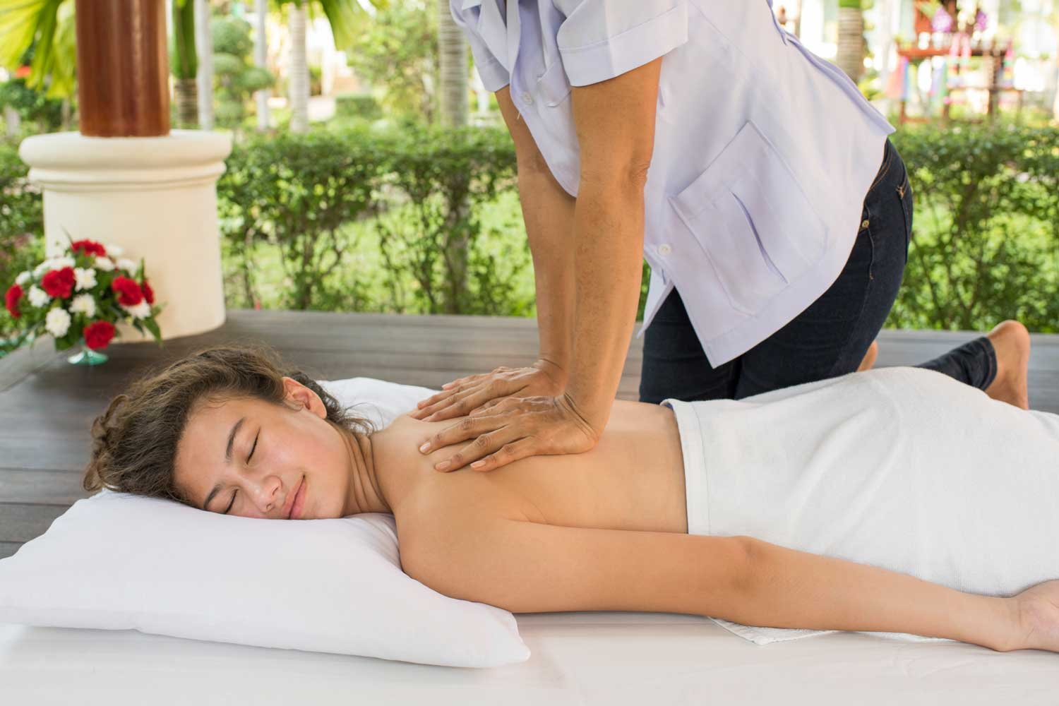 Girl enjoying a traditional Thai massage at Thai Garden Resort in Pattaya Thailand