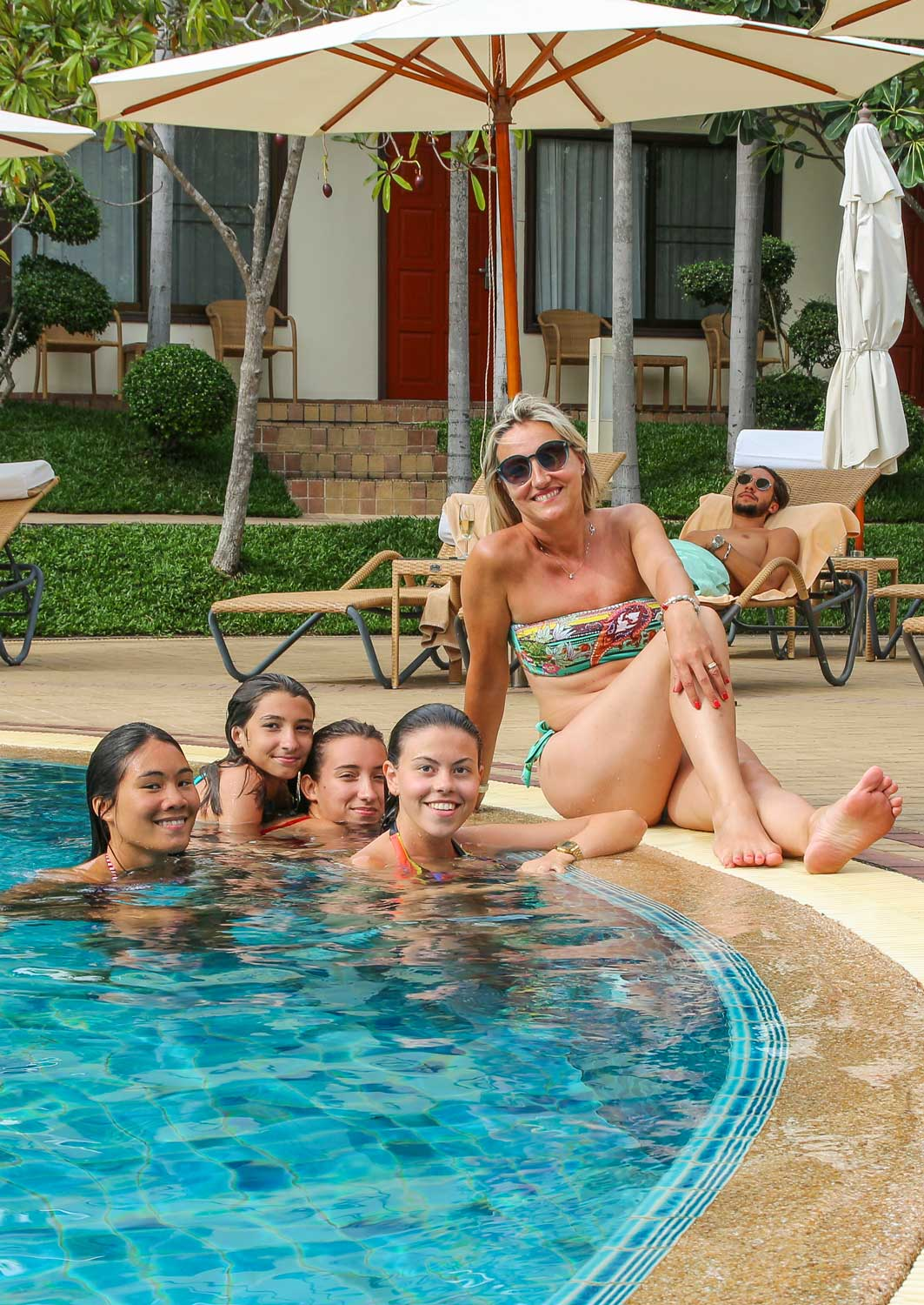 Family at the pool at Thai Garden Resort in Pattaya Thailand
